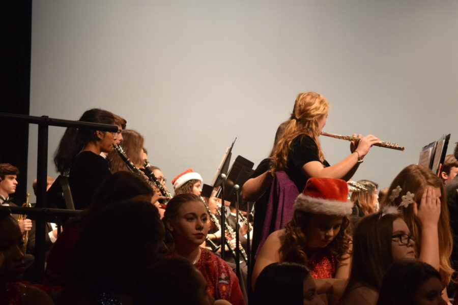 McKenna Dunn and Ketki Morabkar show their musical talents during the Holiday Music Assembly.