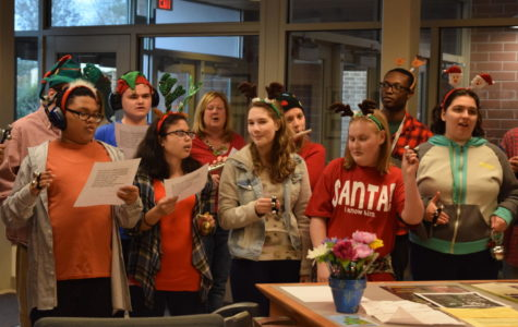Students and teachers from the Autism suite surprise the front office staff with a holiday surprise.