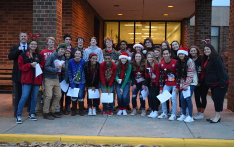Members of the Principal's Leadership Team deliver cookies, cocoa, and Christmas carols to bus drivers.