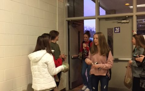Trojans for Tomorrow club members distribute Kindness Kanes on the first day of exams.