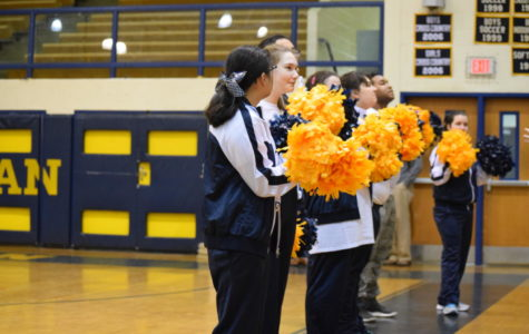 Midlo's cheerleaders cheer on their team on Midlo's home court.