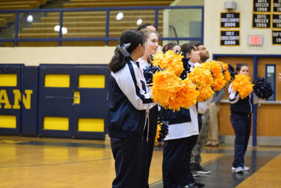 Midlo's cheerleaders cheer on their team on Midlo's home court.