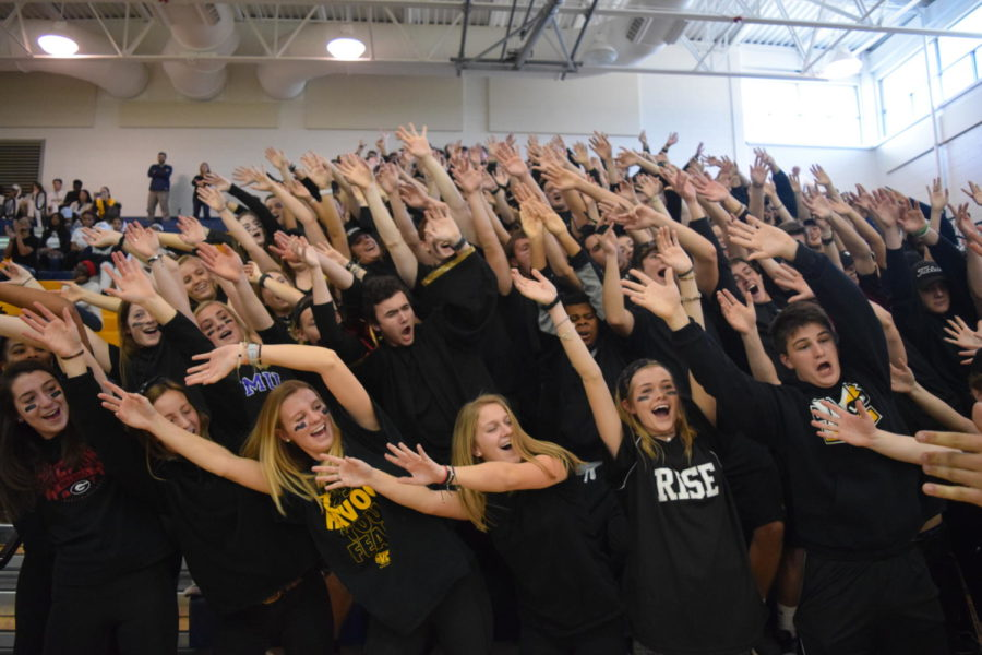 Seniors+show+off+their+famous+roller+coaster+cheer+at+the+winter+pep+rally.