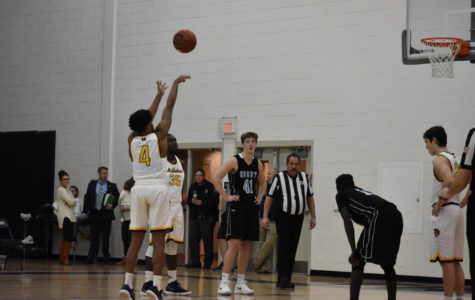 Amir Reid shoots a free throw and scores a point for Midlo.