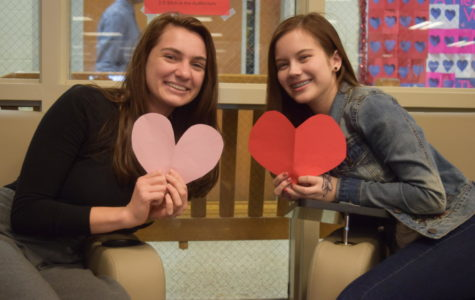 Carrie Rowley and Caitlin Woods joke about taking each other out for Valentine's Day.
