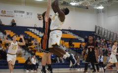 Trojans Men's Basketball Wins Big in First Home Playoff Game in Years