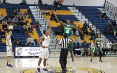 Midlo Men's Basketball Suffers Tough Loss to Huguenot