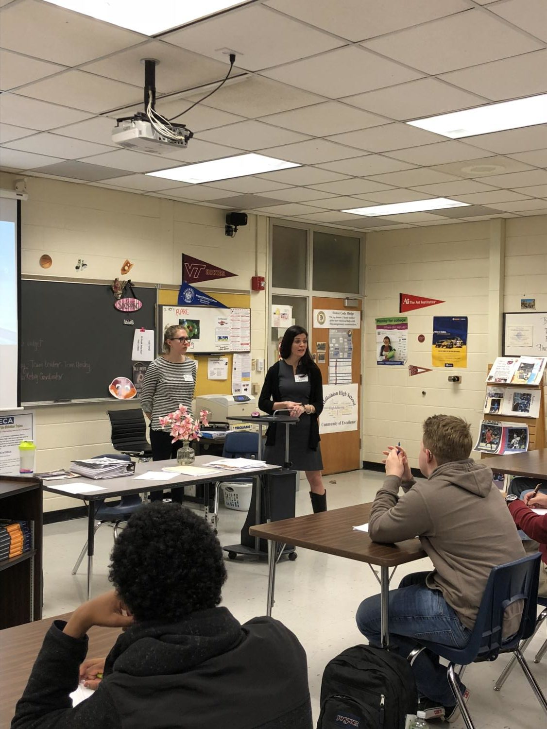 Annemarie Hensley and Macie Wall speak to IB Business Management classes about the fundamentals of real estate marketing.