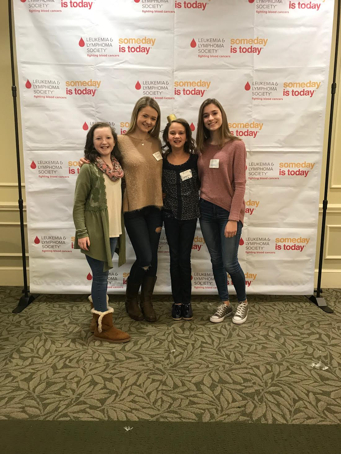 Juniors Lauren Hensley and Kirsten Hebb stand with the Leukemia & Lymphoma Society through their search for cancer cures.