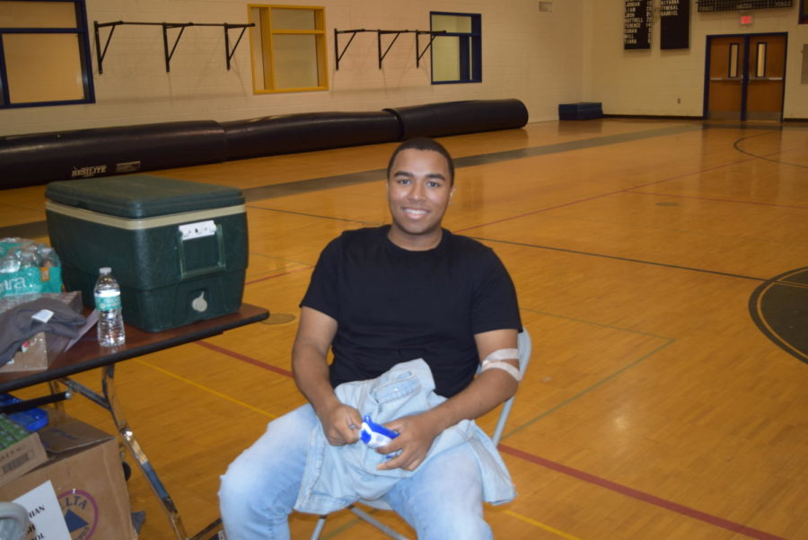 Chris Haynes eats a snack after successfully donating a pint of blood.