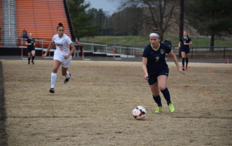 Bailey Honrado dribbles the ball up the field.