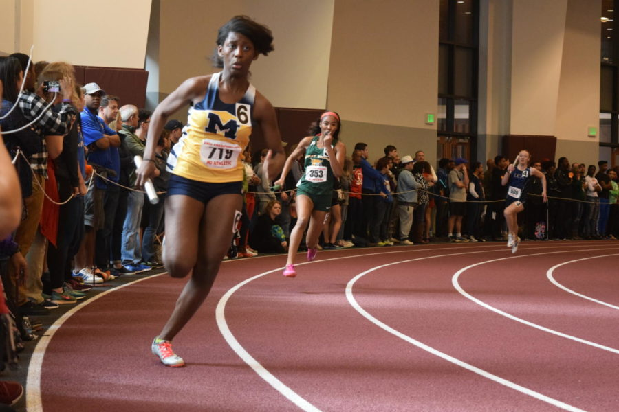 Dasia Hardy flies around the bend in the first leg of the girls 4x200 relay.