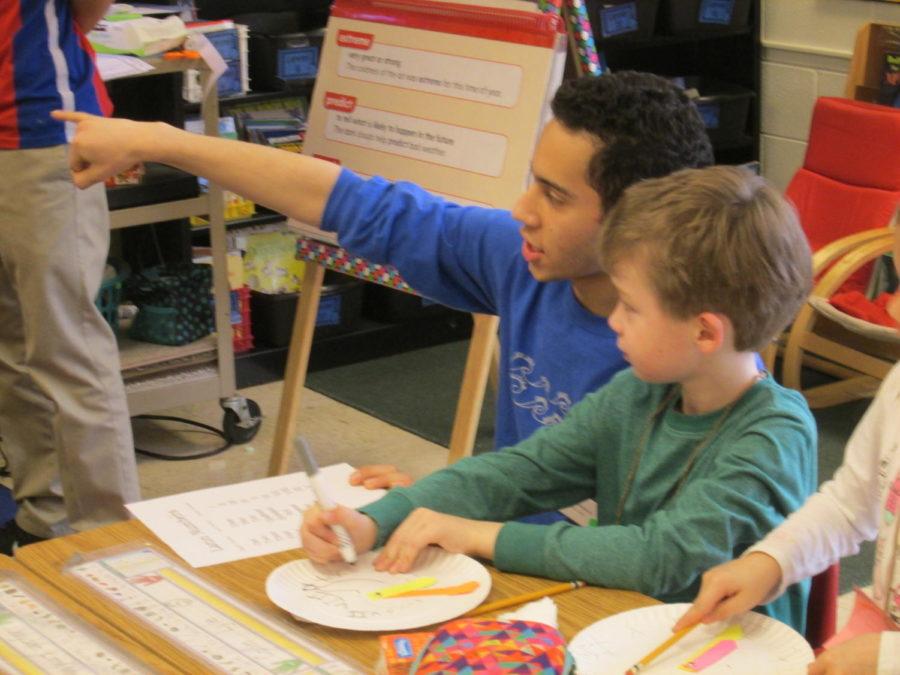 Josue+Candelaria+teaches+Latin+basics+to+first+graders+at+J.B.+Watkins.