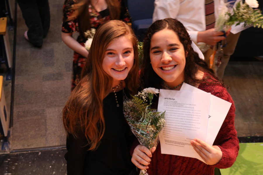 Juniors Lily Hayes and Samantha Boero show off their honors and certificates at the National Honor Society induction.