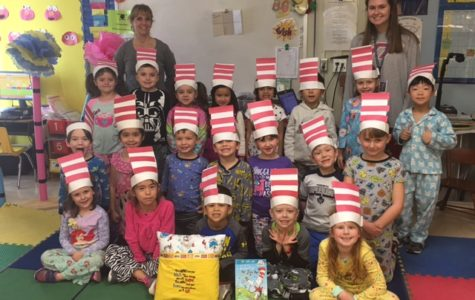 Mrs. McMullen's kindergarten class celebrates Dr. Seuss Day with Cat in the Hat hats and a special gift from Mrs. Klotz.