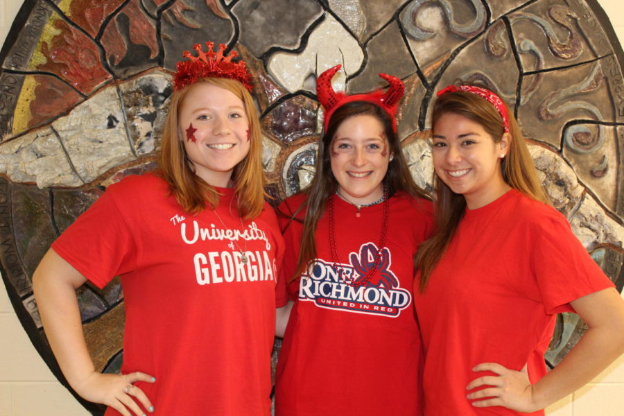 Seniors Hallie Strickland, Emily Smith, and Addie White wear red to show their Senior Midlo Pride.
