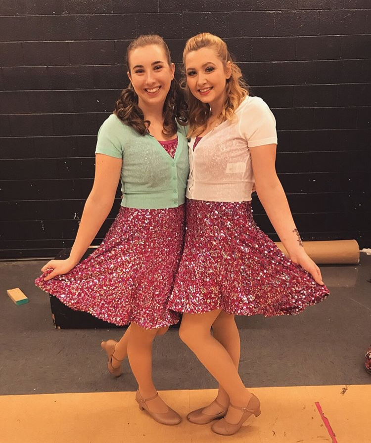 Elizabeth Czenczek and Megan Glidewell show off their sparkly dresses.