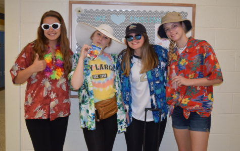 Seniors Hillary Hettinger, Mackenzie Griffin, Kristina Fawcett, and Ashley Smith are the perfect tourists for Tacky Tourist Tuesday during Senior Spirit Week.
