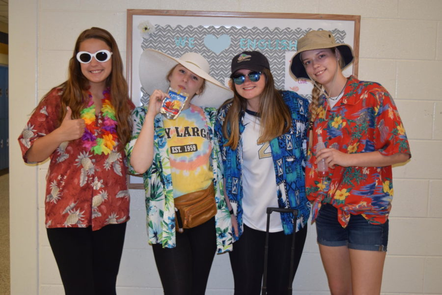 Seniors+Hillary+Hettinger%2C+Mackenzie+Griffin%2C+Kristina+Fawcett%2C+and+Ashley+Smith+are+the+perfect+tourists+for+Tacky+Tourist+Tuesday+during+Senior+Spirit+Week.