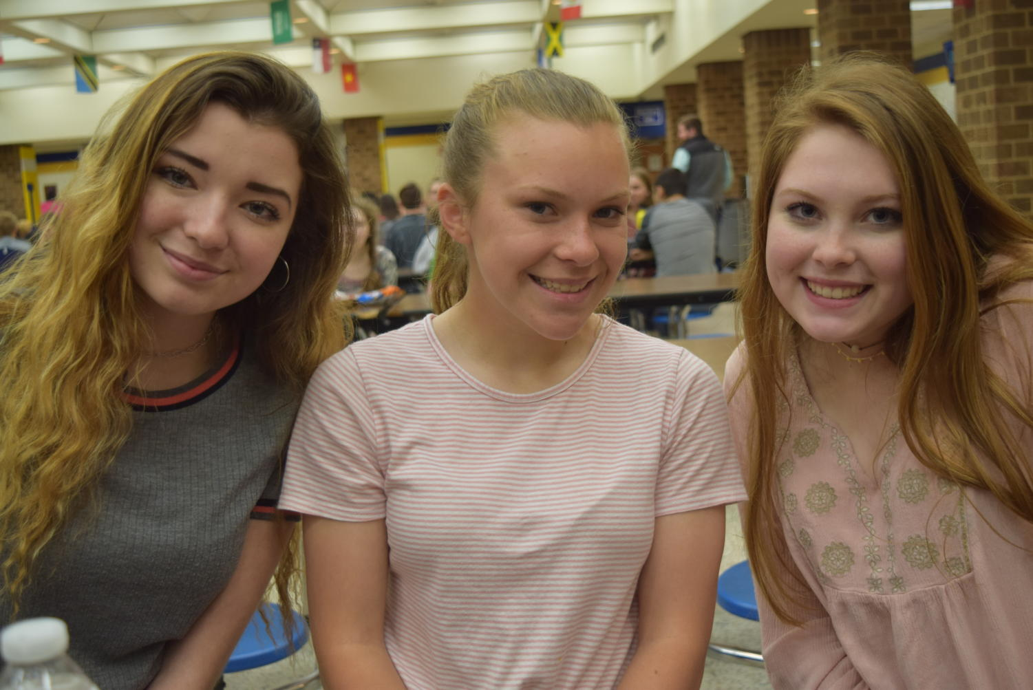 Freshmen Emily Vanlandingham, Madison Salzman, and Emily Peterson enjoy lunch together.