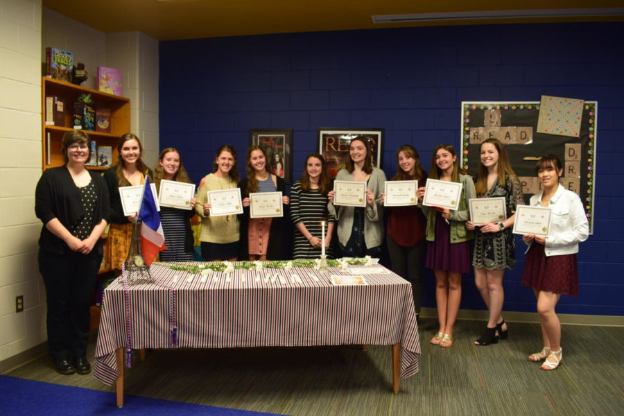 Madame Mazzola introduces the new members of French Honor Society.