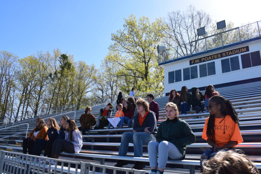Midlo students gather on the bleachers to listen intently as sophomore Emily Muncie shares  opening remarks at the April 20 walkout.