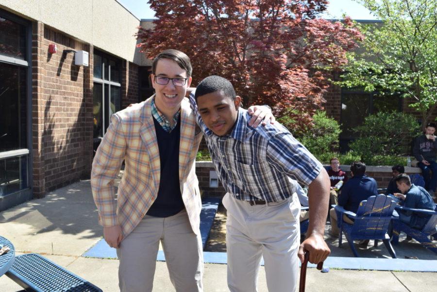 Thomas Olivero and Justin Penn dress up as elderly men for senior citizens vs. kindergartners day.