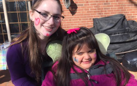 Homework Helpers Easter Egg Hunt: Kimberly Beasley enjoys face painting with her HH friend.
