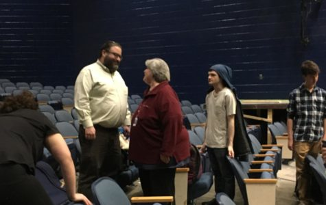 Rabbi Nagel greets Mrs. Katharine Baugher as he visits the Midlothian High School cast of Fiddler on the Roof.