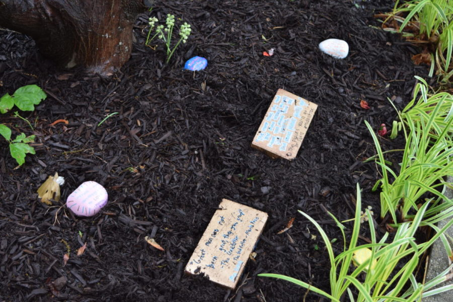 Mrs. Tully's AP Literature students decorated Midlo's Senior Courtyard with their inpirational rocks.
