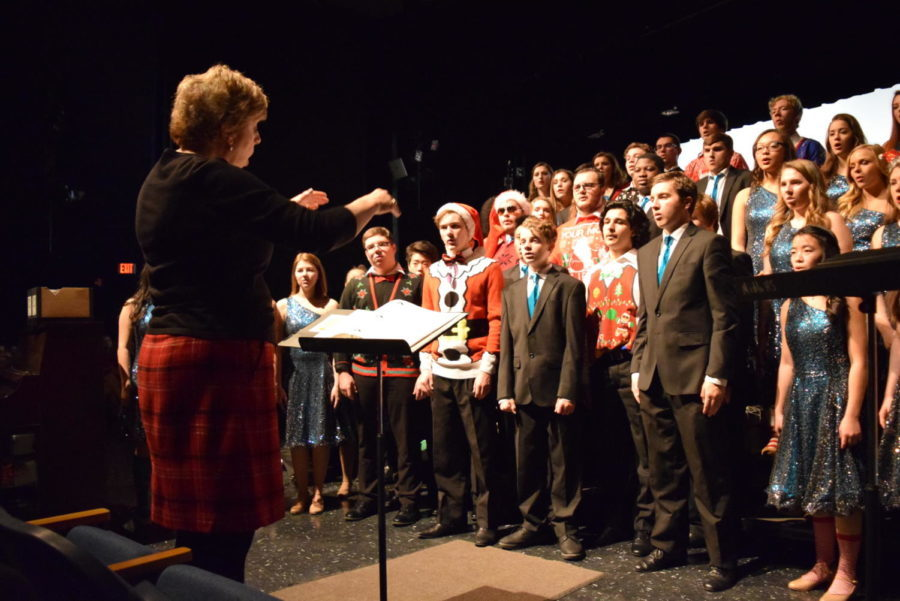 Mrs. Michelle Graham conducts Just for Show, as they sing