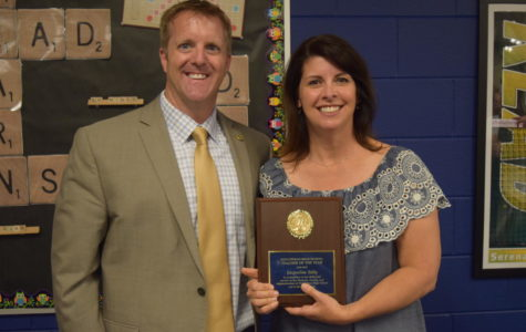 Principal Shawn Abel and Mrs. Tully celebrate her recognition as Midlo Teacher of the Year.