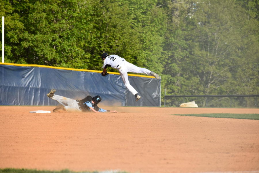 Shortstop Hunter Beck takes flight trying to make the tag at second base.