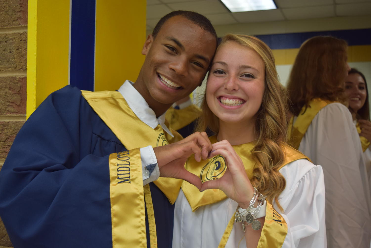 BJ Beckwith and Eva Johnson show their love of the Class of 2018.
