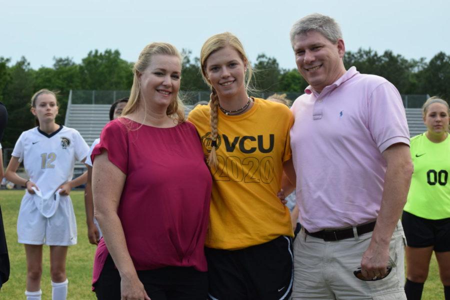 Ashley Smith celebrates Senior Night with her parents.
