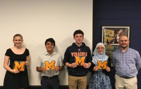 Courtney Galligher, Vincent Mangano, Quentin Phillips, and Nour Goulmamine show off their varsity letters.