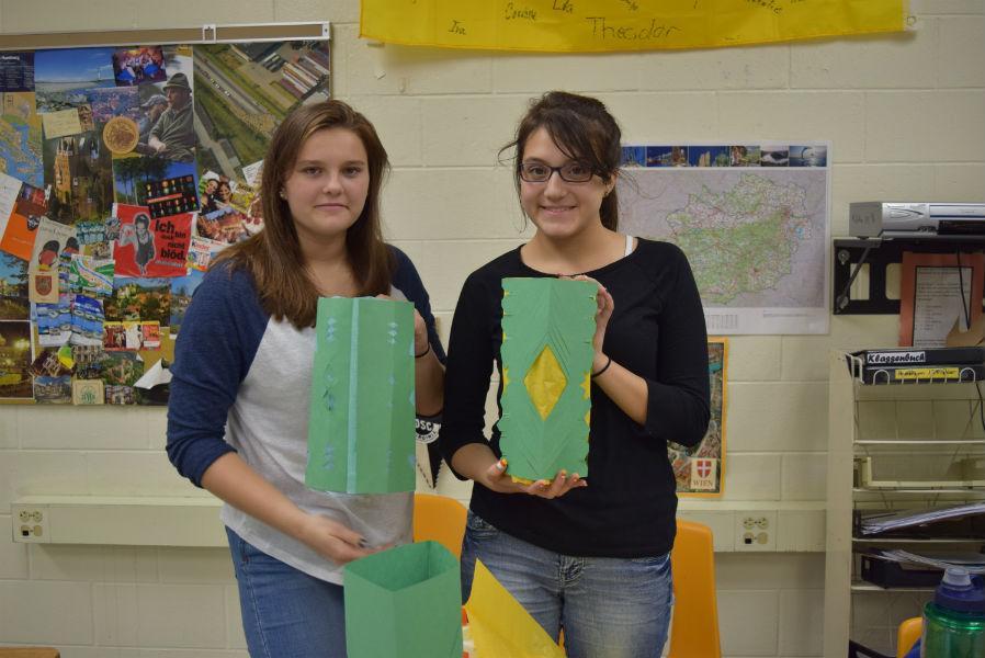 Nora Carlucci and a Tori-Anna Hamilton member make paper lanterns.