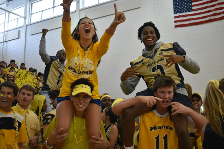 Terry Lee lifts Taylor Chung as Liam Wasson does the same for Jacoby Martin  in celebration of their first pep rally win as seniors.