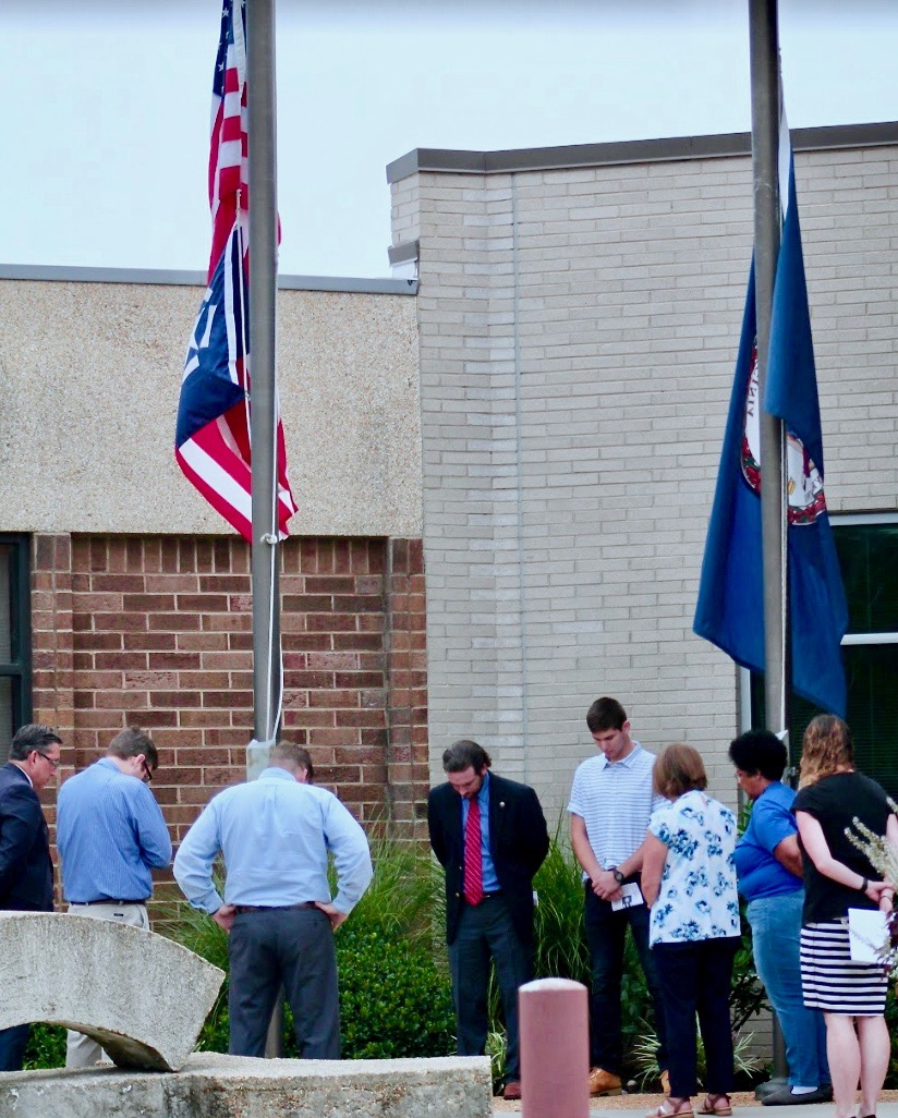 Participants observe a moment of silence for the lives lost during the 9/11 attacks.
