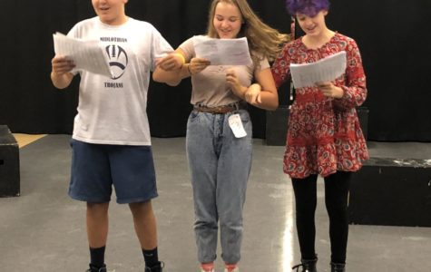 Cohen Steele, Kylie Redden, and Sophia Craig join arms to sing We're Off to see the Wizard!