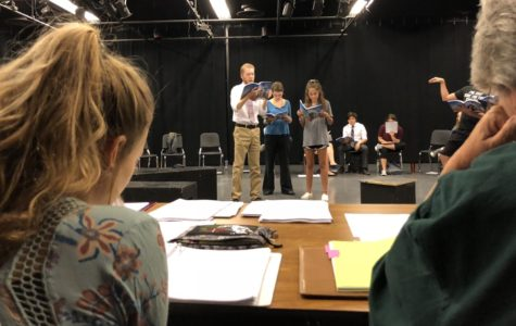 Mrs. Baugher and senior Peyton Strange follow along the script as Sophia Nadder, Yosef Collins, and Alexis Muse read it aloud.
