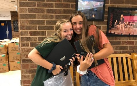 Sarah Aud and Lauren Mission reunite with their Chromebooks.
