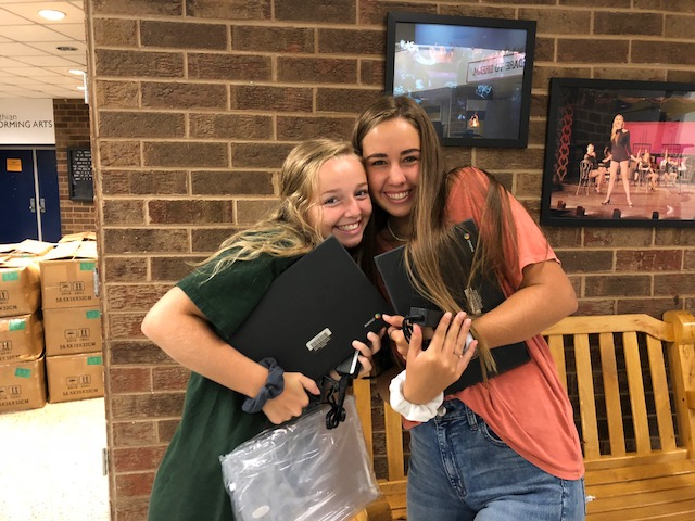 Sarah+Aud+and+Lauren+Mission+reunite+with+their+Chromebooks.+