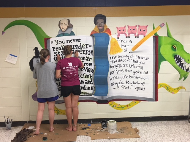 Midlo art students work hard over the summer to complete a new mural for the English hall.