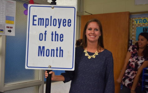 Mrs. Abe gets the employee of the month award for September.