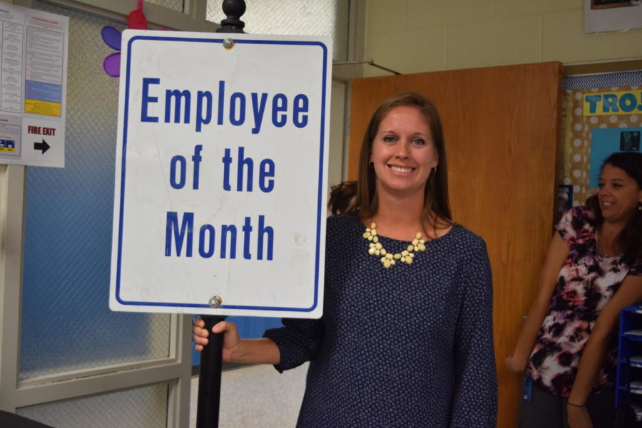 Mrs.+Abe+gets+the+employee+of+the+month+award+for+September.