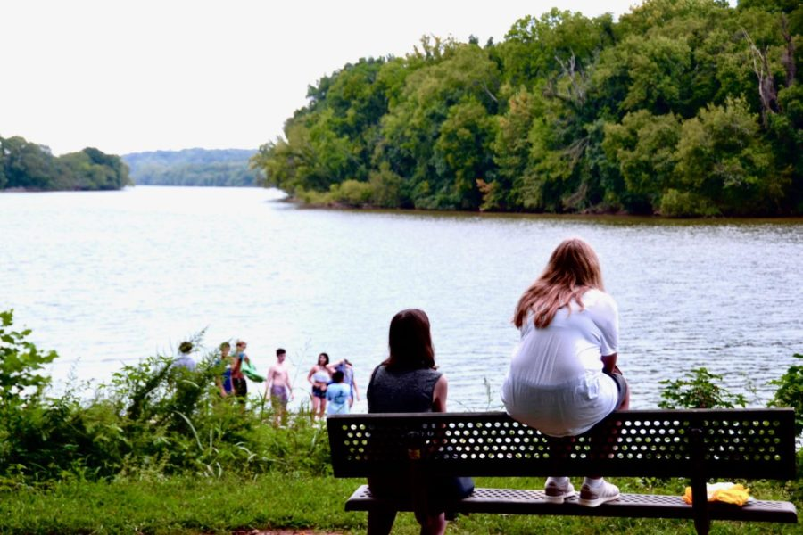 IB students admire the view, while other students prepare to jump into the James River.