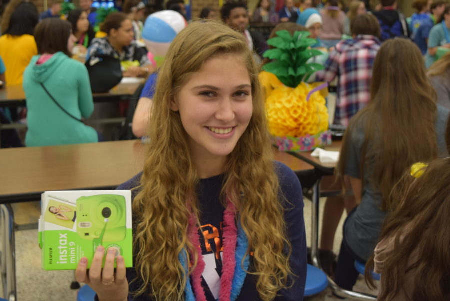 Junior Lauren Reinfeld wins an Instax camera after reading the most books out of all the participants at the Summer Reading Celebration.