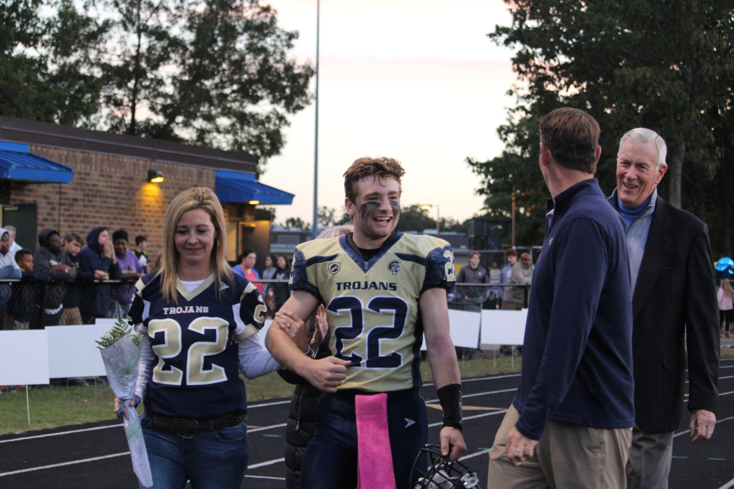 Will Pomeroy enjoys Senior Night with his family at Midlo's final home football game.