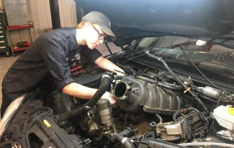 Senior John Kessler repairs cars at Jaguar.